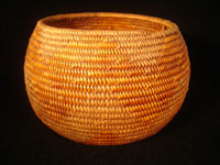 Native American Indian antique basket, Mission basket with original sales tag, 1918. Very finely woven Mission basket with the original sales tag from c. 1918. Various shades of juncus on a deer grass bundle; very tightly coiled. The original sales tag identifies this basket as from the Saboba Reservation, Riverside, California, 1918. The other side of the tag identifies the basket as coming from a Marvin Whitaker of Portland, Oregon, the dealer or original collector. Condition is excellent. Main photo.