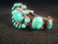 Native American Indian vintage silver jewelry, a Navajo sterling silver bracelet with wonderful natural turquoise stones, c. 1920; ingot silver. The turquoise is about the most beautiful you will ever see!  Photo of one side of Navajo ingot silver bracelet.