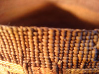 Native American Indian antique Tlingit basket with wonderful geometric bands around the sides, featuring red crosses, c. 1900. A closeup photo of the upper rim of the Tlingit basket.