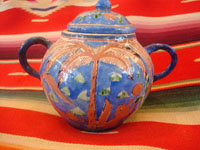 "Mexican vintage pottery and ceramics, creamer and suger set by famed artist Balbino Lucano, c. 1920-30. This is one of the finest examples of Balbino's work that we have ever seen. Beautifully decorated with palm trees and animals chasing each other around the pieces! Signed on bottom of sugar, ""B D Lucano"". Closeup photo."
