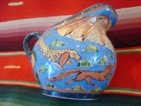 "Mexican vintage pottery and ceramics, creamer and suger set by famed artist Balbino Lucano, c. 1920-30. This is one of the finest examples of Balbino's work that we have ever seen. Beautifully decorated with palm trees and animals chasing each other around the pieces! Signed on bottom of sugar, ""B D Lucano"". Another photo of sugar."