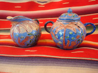 "Mexican vintage pottery and ceramics, creamer and suger set by famed artist Balbino Lucano, c. 1920-30. This is one of the finest examples of Balbino's work that we have ever seen. Beautifully decorated with palm trees and animals chasing each other around the pieces! Signed on bottom of sugar, ""B D Lucano"". Main photo."