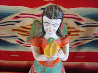 Mexican vintage pottery and ceramics, and Mexican vintage folk art, a candle-holder in the form of an angel, attributed to the famous folk artist Heron Martinez Mendoza, Acatlan, Puebla, c. 1970. Closeup of angel's face.
