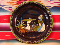 Mexican vintage pottery and ceramics, a blackware plate with wonderful artwork from Tlaquepaque, Jalisco, c. 1930-40's. The plate has a beautiful border and a scene of a campesino carrying his load of wood amidst plants and cacti. This is the second of three plates, probably all by the same great artist. Main photo of plate.