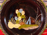 Mexican vintage pottery and ceramics, a blackware plate with wonderful artwork from Tlaquepaque, Jalisco, c. 1930-40's. The plate has a beautiful border and a scene of a lovely house amidst plants and cacti. This is the third Tlaquepaque plate of three, all probably by the same great artist. Photo of the central scene on the front of the plate.