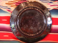 Mexican vintage pottery and ceramics, a blackware plate with wonderful artwork from Tlaquepaque, Jalisco, c. 1930-40's. The plate has a beautiful border and a scene of a lovely house amidst plants and cacti. This is the third Tlaquepaque plate of three, all probably by the same great artist. Photo of the back side of plate.