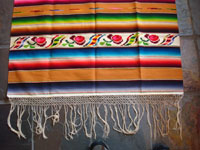 Mexican vintage textiles and sarapes, a lovely Saltillo sarape with a wonderful center diamond of silk, c. 1920's. The predominant color is a lovely golden tan, with very colorful intermittant bands. Another photo of side-bar and fringe.
