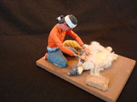 Native American Indian folk-art and wood-carving, a Navajo folk-art wood-carving of a Navajo man shearing his sheep, signed by the artist, c. 1970. Main photo of the Navajo folk-art woodcarving.