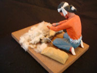 Native American Indian folk-art and wood-carving, a Navajo folk-art wood-carving of a Navajo man shearing his sheep, signed by the artist, c. 1970. Photo of the back of the folk-art carving.
