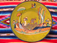 Mexican vintage pottery and ceramics, a very fine pottery charger with a rare lime-green background and wonderfully beautiful artwork, Tlaquepaque, Jalisco, c. 1920-30's. The charger features a wonderful scene of rural Mexican life. Main photo of the Mexican vintage pottery charger.