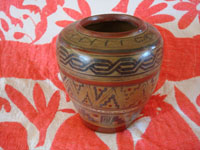 Mexican vintage pottery and ceramics, a wonderful pottery jar with a beautiful patina and Aztec-type geometric designs, Tonala, Jalisco, c. 1930's. Main photo of the jar.