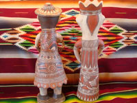 Mexican vintage folk art, and Mexican vintage pottery and ceramics, a pair of pottery statues, a man and woman, from Guerrero, c. 1970's. Photo showing the back side of the figures.