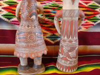 Mexican vintage folk art, and Mexican vintage pottery and ceramics, a pair of pottery statues, a man and woman, from Guerrero, c. 1970's. Closeup photo of the back side of the figures.