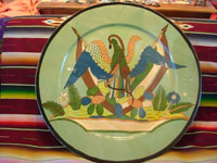 Mexican vintage pottery and ceramics, a magnificent and extremely large charger featuring the Mexican national symbol, an eagle with snake in mouth and two Mexican flags, Tonala or Tlaquepaque, Jalisco, c. 1920-30's. Main photo of charger.