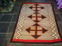 Native American Indian vintage textiles, a Navajo Crystal rug with striking crosses, c. 1920-30's. The design of the weaving is powerful, and the colors are vibrant and bold. Main photo of rug.