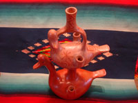 Mexican vintage folk art, and Mexican vintage pottery and ceramics, a pottery candleholder in the form of wonderful ducks, stacked one upon the other, beautifully burnished and with great decorations, signed by the famous Mexican folk artist, Heron Martinez, Acatlan, Puebla, c. 1960's. Main photo of the Heron Martinez pottery piece.