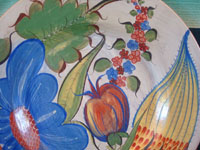Mexican vintage pottery and ceramics, a burnished Tonala charger with incredibly fine hand-painted decoration, Tonala or Tlaquepaque, Jalisco, c. 1930's. Closeup photo of the decorations on the front of the Tonala burnished pottery charger.