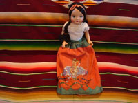 "Vintage Mexican folk art, a lovely ""China Poblana"" folk art doll with a beautiful face and wonderful sequins on her dress, depicting the Mexican eagle, c. 1940's. Main photo of the doll."