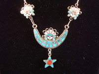 Native American Indian silver jewelry, and Zuni sterling silver jewelry, a lovely silver necklace with a hand-made silver chain and wonderful inlay work of turquoise, mother of pearl, jet, and corral, Zuni Pueblo, c. 1950's.  Closeup photo of the crescent moon naja at the bottom of the Zuni Indian silver jewelry necklace.