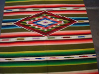 Mexican vintage textiles and serapes (sarapes), a lovely Saltillo serape with a wonderful avocado-green background and intricate center medallion, c. 1930's.  Closeup photo of the center part of the Saltillo serape.