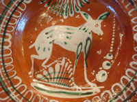 Mexican vintage pottery and ceramics, a wonderful bandera-ware plate decorated with a graceful deer, Tonala or San Pedro Tlaquepaque, Jalisco, c. 1930's.  Closeup photo of the deer on the front of the bandera ware plate.