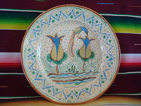 Mexican vintage pottery and ceramics, a beautiful pottery plate with the granillo background (resembling falling hail) and lovely artwork, Tonala or San Pedro Tlaquepaque, Jalisco, c. 1930's.  Main photo of the plate.