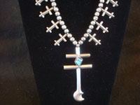 Native American Indian vintage silver jewelry, and Navajo vintage sterling silver jewelry, a beautiful Navajo silver necklace with lovely turquoise, Arizona or New Mexico c. 1940-50's. Closeup photo of the main cross on the Navajo silver jewelry necklace with crosses.