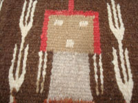 Native American Indian textiles, and Navajo vintage textiles and rugs, a beautiful Navajo textile depicting Navajo spiritual Yei figures, Arizona or New Mexico, c. 1940's. Closeup photo of the face of one of the Navajo Yei figures.