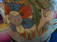 Mexican vintage pottery and ceramics, a lovely petatillo pottery pitcher with wonderful and precise artwork, Tonala or San Pedro Tlaquepaque, Jalisco, c. 1940's. A closeup photo of some of the floral decorations on the pitcher.