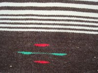 Mexican vintage textiles and sarapes (serapes), a wonderful Texcoco woolen rug with natural wool colors of brown and beige, with some red and green analine-dyed accents, Texcoco, c. 1940's. Closeup photo of one end of the Texcoco blanket.