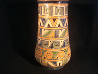 Mexican vintage pottery and ceramics, a pottery vase from Tonala, Jalisco, c. 1930. The vase has wonderful Aztec designs and very fine petatillo (straw-like hatching in the background) in many areas. Another photo of the entire vase.