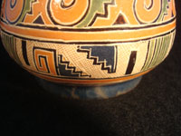 Mexican vintage pottery and ceramics, a pottery vase from Tonala, Jalisco, c. 1930. The vase has wonderful Aztec designs and very fine petatillo (straw-like hatching in the background) in many areas. Closeup photo near base.