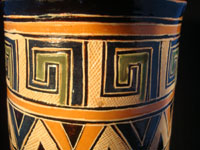 Mexican vintage pottery and ceramics, a pottery vase from Tonala, Jalisco, c. 1930. The vase has wonderful Aztec designs and very fine petatillo (straw-like hatching in the background) in many areas. Closeup photo near top.