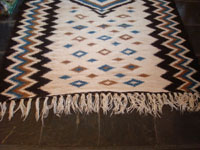 Mexican vintage sarapes and textiles, a rare Mayo weaving, c. 1930. Beautifully woven of wonderfully soft wool, and with vibrant colors of blue and brown. Photo showing one end of the Mayo textile.