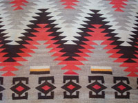 Native American Indian vintage textile, a Navajo Red-Mesa weaving, c. 1930-1940. The border shows a Tees Nos Pas influence. Very well woven with an eye-dazzler center design. A closeup photo of the Red Mesa textile.