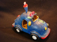 Mexican vintage pottery and ceramics, and Mexican vintage folk-art, a bright blue car or taxi, filled with happy passengers, attributed to the great folk-artist, Candelario Medrano of Jalisco, c. 1960's. Main photo of the Medrano car.