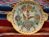 Mexican vintage pottery and ceramics, a wonderful Talavera plate with exquisite artwork, Puebla, c. 1950's. The artwork features a beautiful bird amidst plants and flowers. Main photo of the Talavera plate from Puebla.