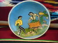 AE-1: Mexican vintage pottery and ceramics, a tea-cup and saucer with incredibly fine artwork, featuring a lovely Charra, dressed in her China Poblana costume, doing the famous dance, El Jarabe Tapatio, Tlaquepaque or Tonala, Jalisco, c. 1930. Closeup photo of the front of the saucer.