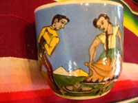 AE-1: Mexican vintage pottery and ceramics, a tea-cup and saucer with incredibly fine artwork, featuring a lovely Charra, dressed in her China Poblana costume, doing the famous dance, El Jarabe Tapatio, Tlaquepaque or Tonala, Jalisco, c. 1930. Another view of the dancers on the sides of the cup.
