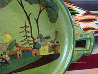 Mexican vintage pottery and ceramics, a beautiful oval platter with a lovely green background and excellent artwork, Tlaquepaque or Tonala, Jalisco, c. 1930's. Closeup photo of one end of the charger showing the lovely handle.