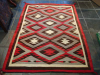 Native American Indian antique textiles, and antique Navajo rugs, a beautiful Navajo rug, in the Ganado style, c. 1930's. Main photo of the fine Navajo rug or weaving.