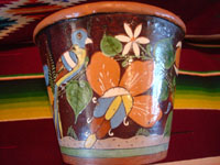 Mexican vintage pottery and ceramics, a pair of planters, very early and with exquisite artwork, Tlaquepaque or Tonala, Jalisco, c. 1920-30's. The scenes decorating these planters are incredible, with verdant plants, burros, birds, and animals, including graceful deer. A side view of one of the planters, showing a lovely bird amidst foliage.