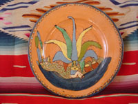 Mexican vintage pottery and ceramics, a beautiful pottery plate with a very finely painted scene of a Mexican campesino resting under his favorite maguey cactus, Tonala or Tlaquepaque, Jalisco, c. 1940's. Main photo.