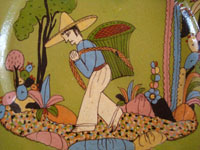Mexican vintage pottery and ceramics, a wonderful pottery plate with a beautiful pale-green background glazing, and a fine scene of a Mexican campesino in a beautiful rural setting, Tonala or Tlaquepaque, Jalisco, c. 1940's.  Closeup photo of the campesino.