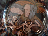 Mexican vintage pottery and ceramics, a beautiful pottery plate with a very wonderful background glazing and featuring a very beautiful eagle or exotic bird, Tonala or Tlaquepaque, Jalisco, c. 1930's. Closeup photo of the eagle or exotic bird on the front of the Tlaquepaque pottery plate.
