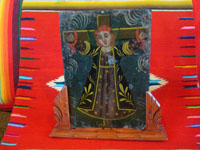 Mexican vintage devotional art, and Mexican vintage tinwork art, a lovely retablo painted on tin depicting Santa Liberata tied to a cross, Mexico, c. 1920. Main photo of the retablo.