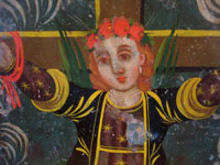 Mexican vintage devotional art, and Mexican vintage tinwork art, a lovely retablo painted on tin depicting Santa Liberata tied to a cross, Mexico, c. 1920. Another closeup photo of the saint's face.