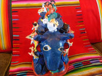 Mexican vintage folk art, and Mexican vintage pottery and ceramics, a wonderful folk-art blue, raging bull with matadors all over his back, attributed to the late Candelario Medrano, Santa Cruz de las Huertas, Jalisco, c. 1950's. A photo shot from in front of the blue bull.