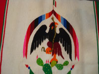 Mexican vintage textiles and Saltillo-style sarapes (serapes), a beautiful sarape with a lovely image of the Mexican flag, with the eagle and serpent, atop a beautiful cactus, c. 1930. Closeup photo of the eagle at the center of the Saltillo serape.