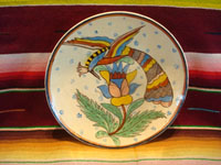 Mexican vintage pottery and ceramics, a wonderful Tlaquepaque pottery plate with a beige background glaze and incredibly crisp and fine artwork, featuring a graceful tropical bird, Tonala or San Pedro Tlaquepaque, Jalisco, c. 1930's. Main photo of the front of the plate showing the lovely tropical bird atop flowers.